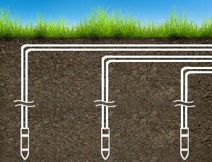 Illustration af vertikale jordvarmeopsamlere